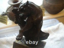 Vintage bronze of a big cat biting at a thorn in leg signed on marble base