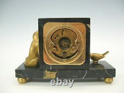 Horloge De Bureau De Bronze Et D'oiseau De Bronze D'art Déco Sur La Base De Marbre Noir